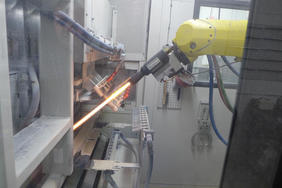Photo: Thermal coating equipment emitting light beam