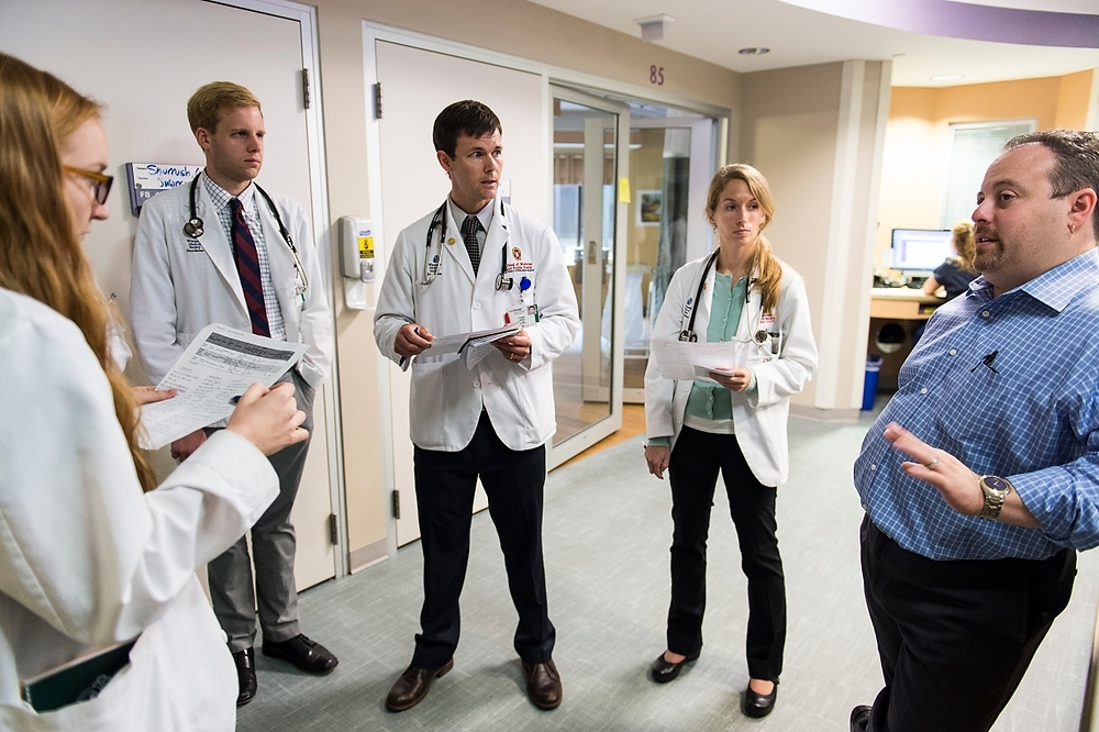 Photo: Josh Medow with medical students on rounds