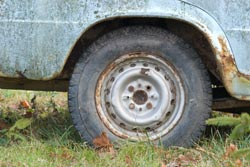 Photo of a rusty car wheel