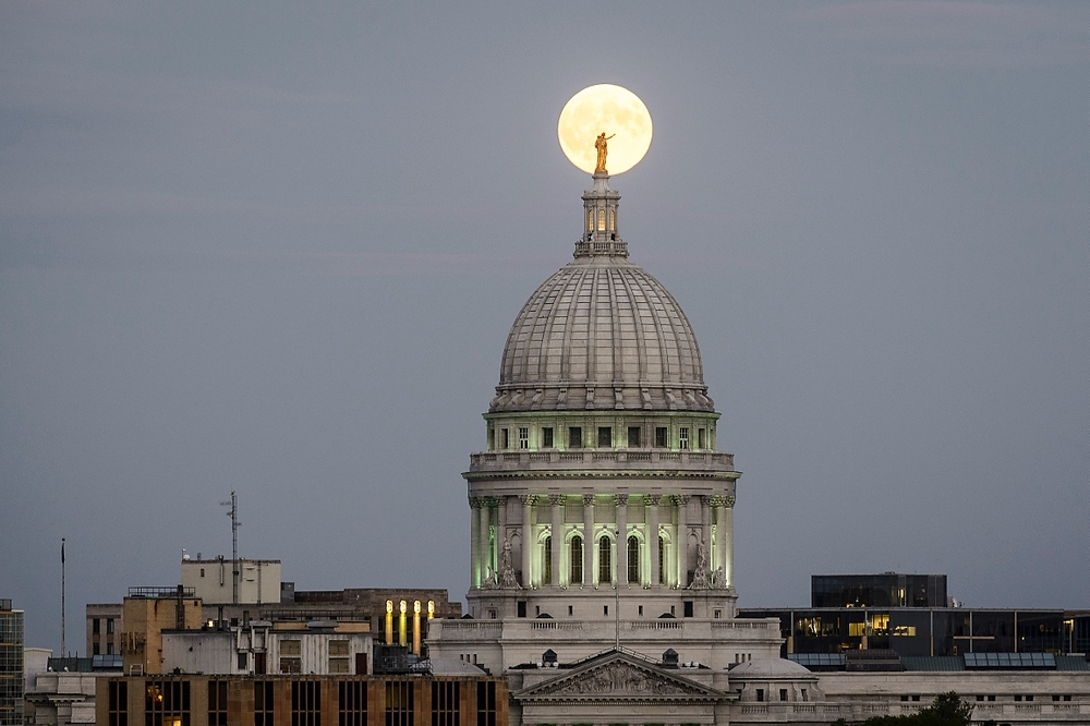 Photo: Moon behind Capitol dome statue