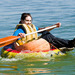 Photo: Student paddling in giant pumpkin