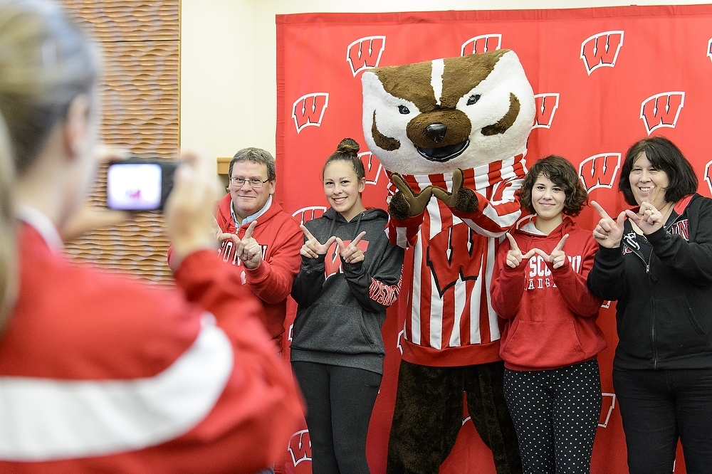 Photo: Family having picture taken with Bucky Badger