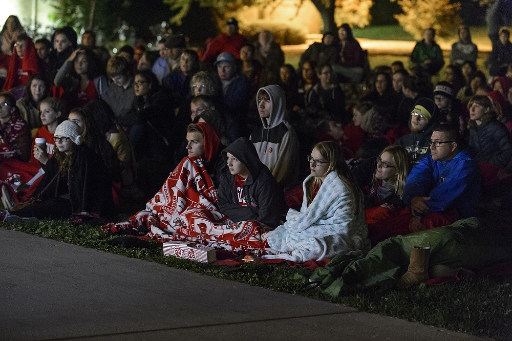 Photo: People watching movie outside Dejope Residence Hall