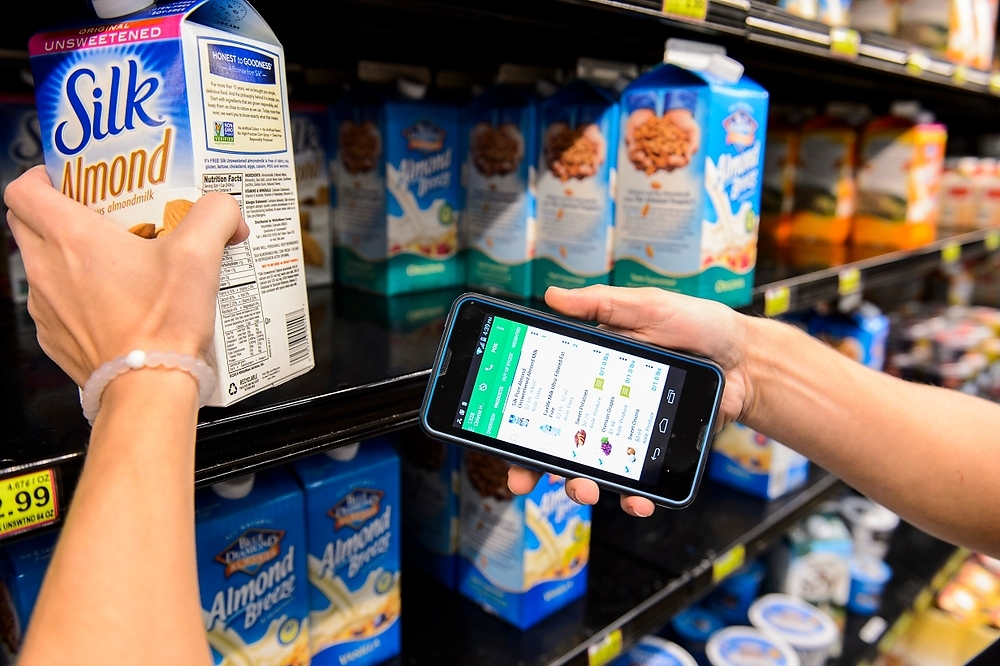 Photo: Person using smartphone to scan food item