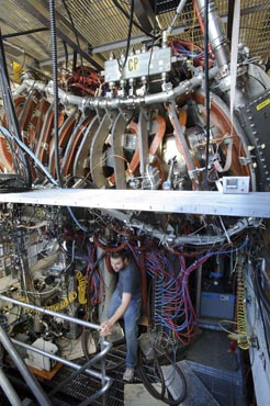 Photo of a man surrounded by electrical equipment.