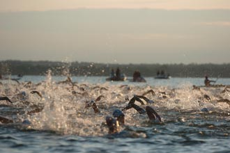 Photo of Ironman contestants during the swim portion of the event.