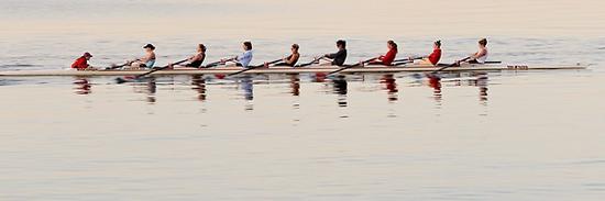 Photo: Crew team rowing on lake
