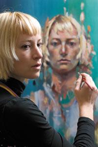 Photo of Katelyn Alain working on a self-portrait