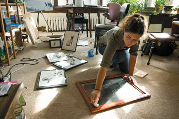 Photo of Michelle Bridwell cleaning her artwork