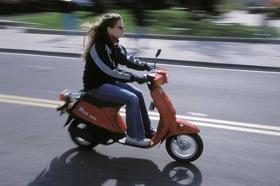 Photo: Moped rider