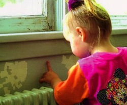 Photo: child near lead paint