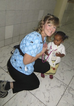 Photo: UW nurse with Ethiopian child