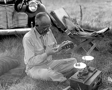 Photo of Aldo Leopold doing reearch in the field