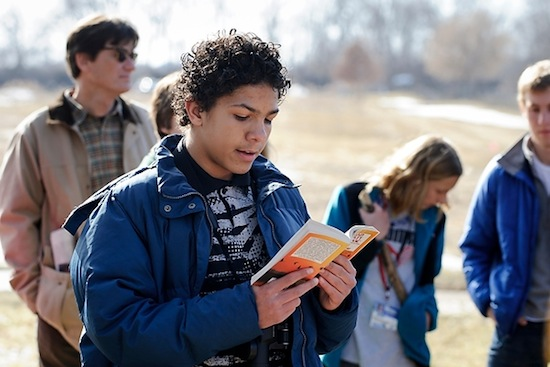 "Photo: middle school student reading from ""A Sand County Almanac"""