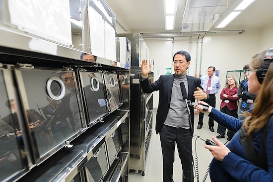 Photo: Yoshihiro Kawaoka talks to media at flu lab