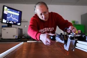 Photo: Dan Wahl operating laser