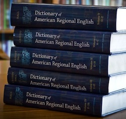 Photo: stack of volumes of Dictionary of American Regional English