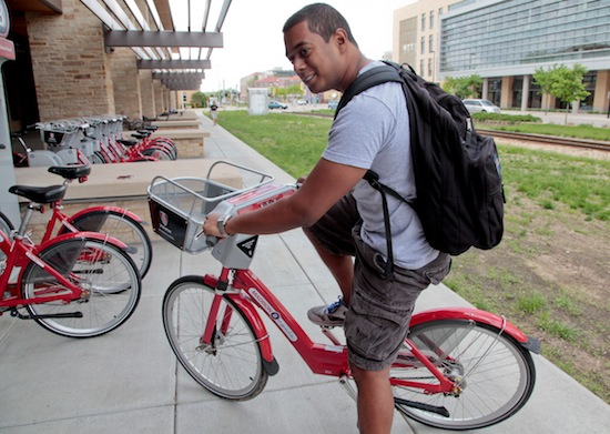 Photo: grad student renting bicycle