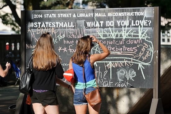 Photo: students facing chalkboard