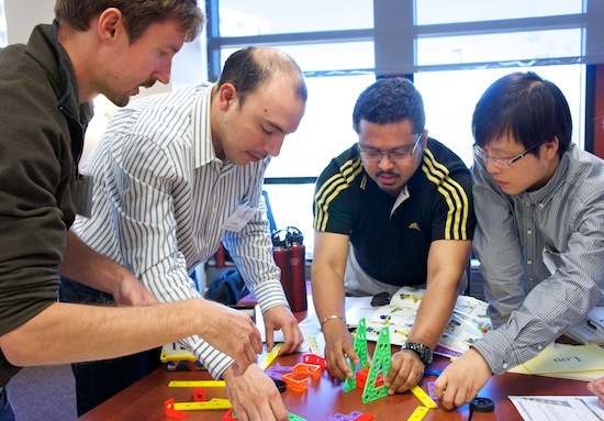 Photo: students building toy tower