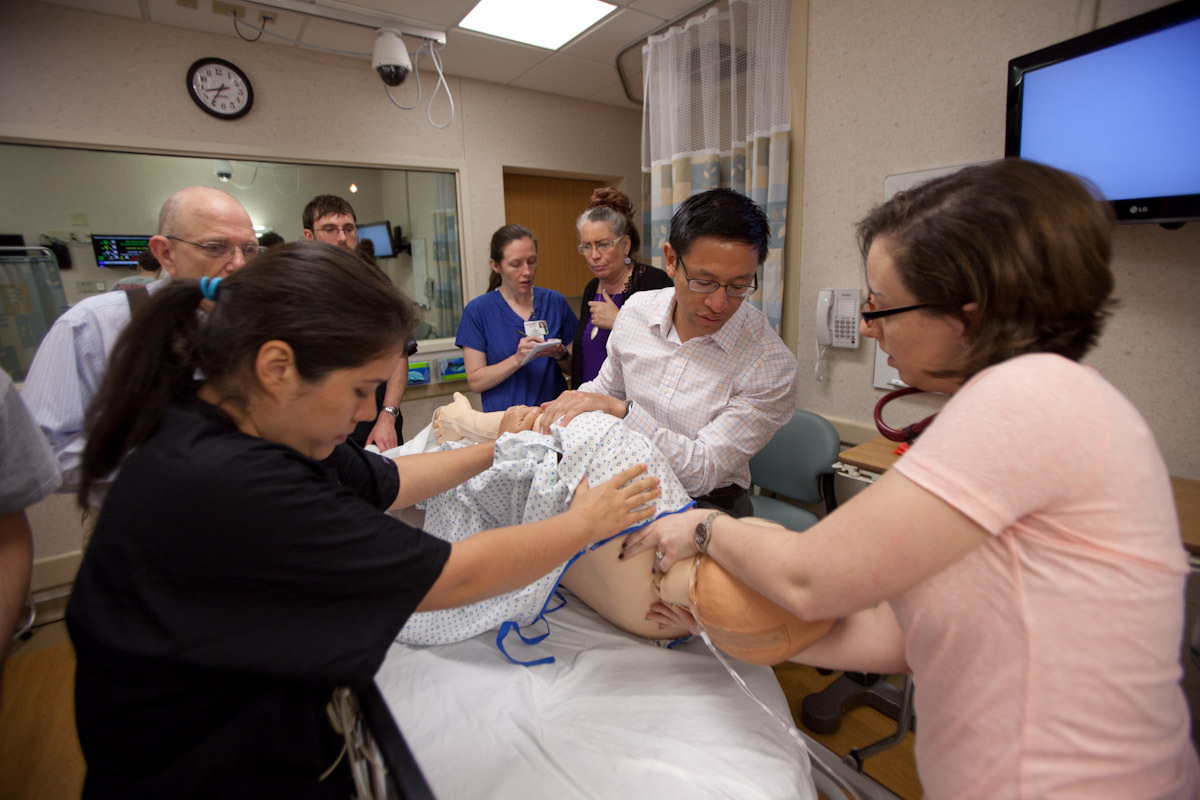 Medical residents working on simulated patient