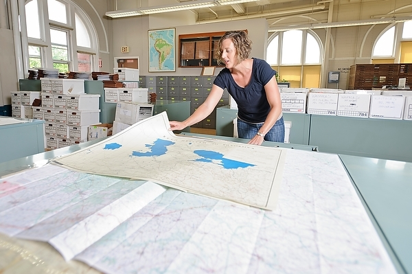 Photo: Jaime Stoltenberg looking at maps