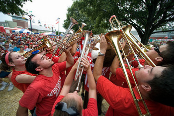 Photo: marching band members playing instruments