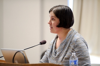 Photo: Heather Daniels speaking into microphone
