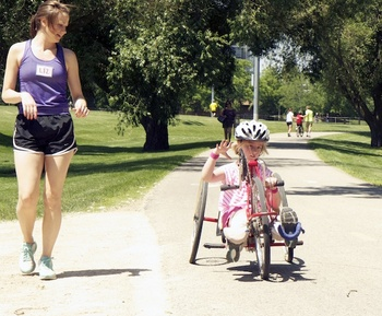 Photo: child riding adapted recumbent bike