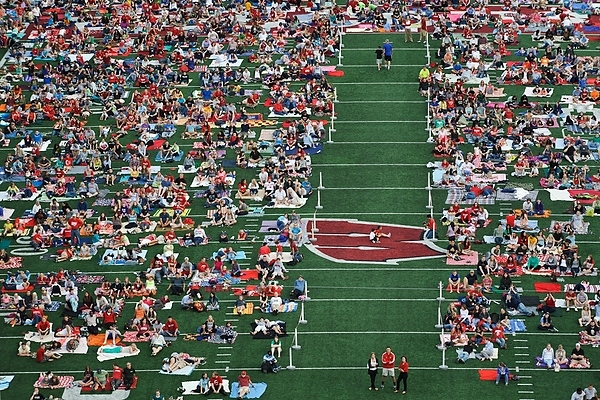 Photo: movie viewers sitting on Camp Randall turf