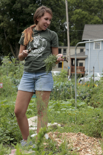 Photo: volunteer weeding garden