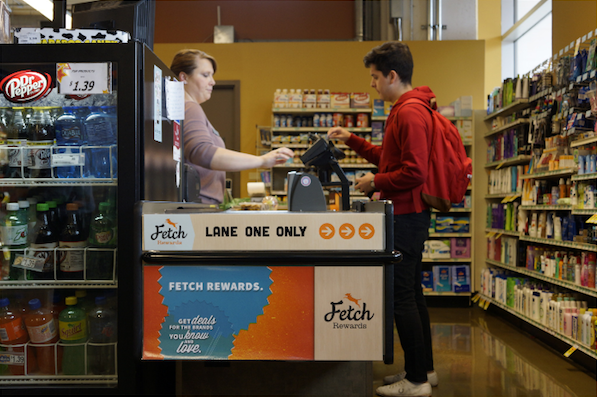 Photo: customer using Fetch checkout lane at grocery store