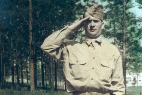 Photo: Pfc. Lawrence Gordon saluting