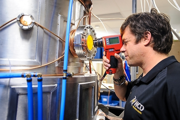 Photo: Patrick Heaney checking a vacuum chamber