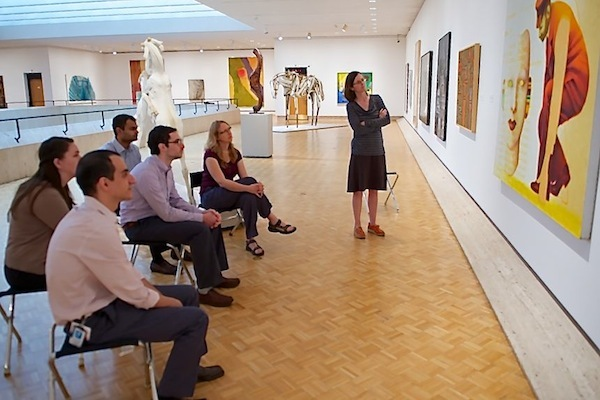 Photo: medical residents looking at painting in art museum