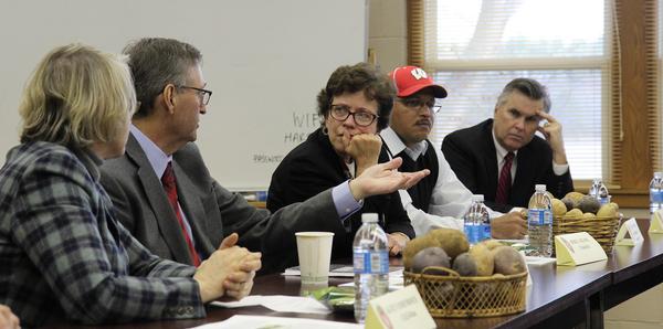 Photo: Rebecca Blank listening to potato grower
