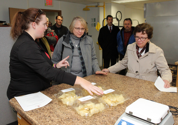 Photo: Research specialist Amber Gotch (left) explains potato chip research to Dean VandenBosch and Chancellor Blank.