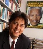 Photo: Heinz Klug in front of Mandela poster