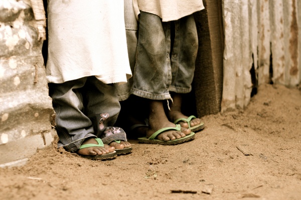 Photo: African children's feet in flip-flops