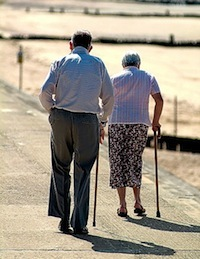 Photo: Elderly couple walking with canes