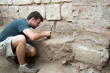 Photo: Will Bruce excavates a coin horde