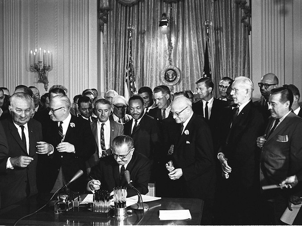 LBJ signs Civil Rights Act of 1964