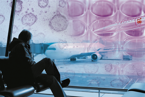 Photo illustration: stem cells superimposed over man sitting in airport