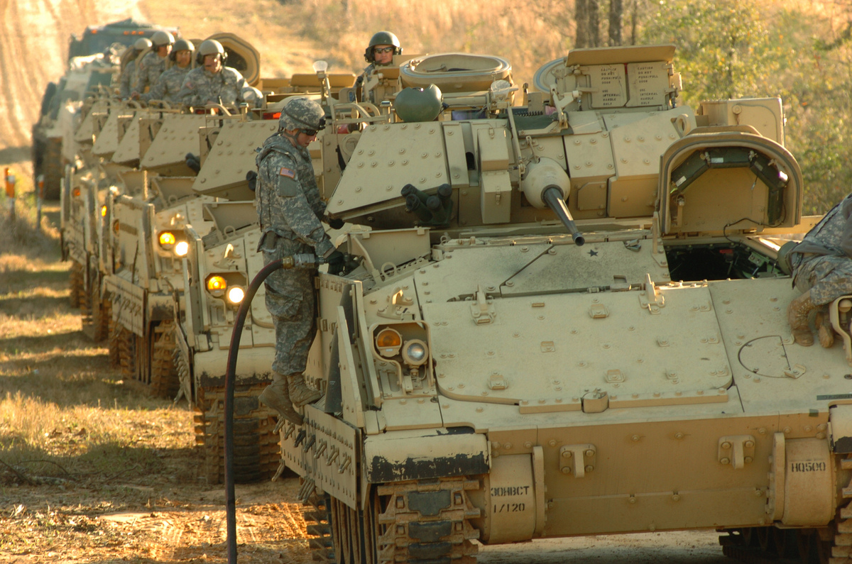 Photo: soldier fueling fighting vehicle