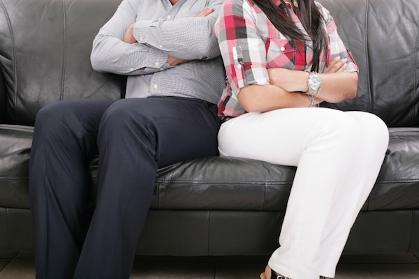 Photo: couple on couch facing away from each other