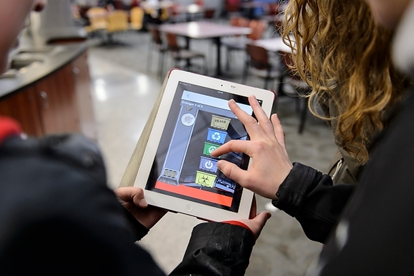 Photo: students playing game on tablet