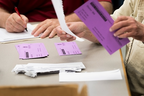 Photo: Classified staff election ballots being counted