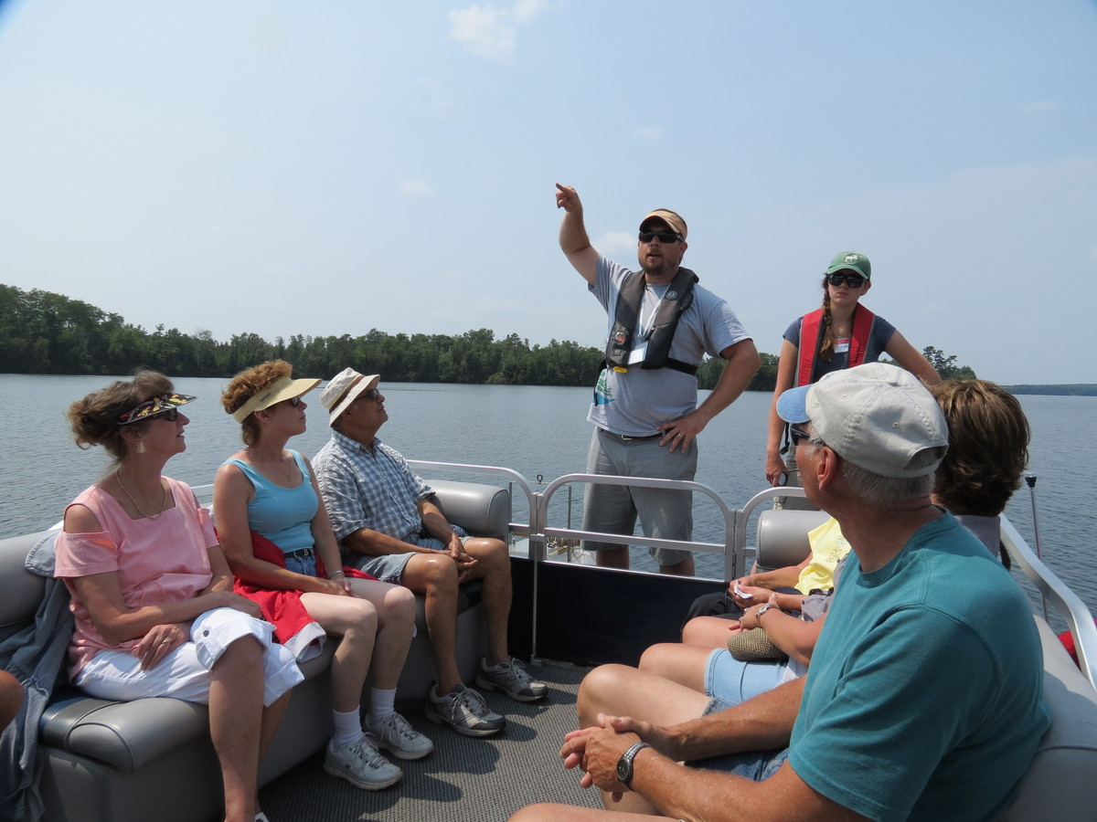 Photo: Trout Lake Station scientist leading boat tour
