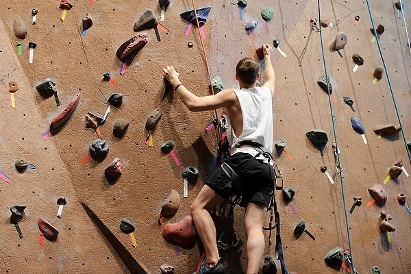Photo: Hoofer Mountaineering Club member climbing rock wall at Union South