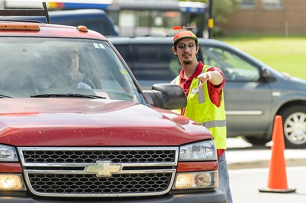Photo: volunteer directing traffic